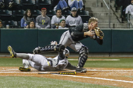 Brandon Cuddy slides into home against New Mexico