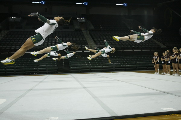 Flying through the air in team floor work.