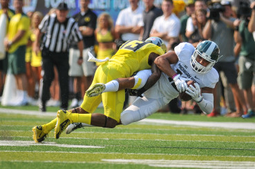 Troy Hill makes the tackle on a Michigan State player