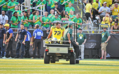 A sullen Yruretagoyena is carted off the the field during the Michigan State game last year. Andre says he still hasn't fully recovered from the injury sustained in that game.