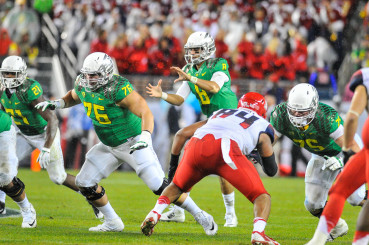 Thanks to solid blocking from Fisher and Co., the Ducks ran rough shod over the Wildcats in the Pac-12 Championship game.