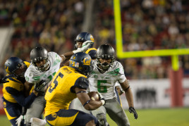 Charles Nelson prepares to tackle a Cal player
