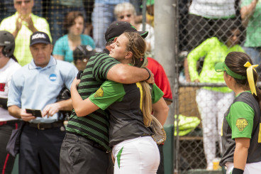 Karissa Hovinga hugs coach White after pitching for the last time at Howe Field