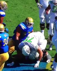Eddie Vanderdoes steals a page from Coach Mora's self-control book and teaches Jake Fisher who not to pancake.