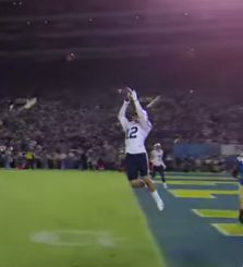 Despite this interception and two others, UCLA moved up in the ranking by beating a lesser team by one point.