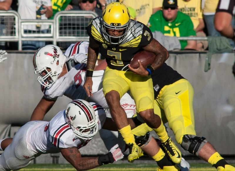 Vernon Adams carries against Eastern Washington.