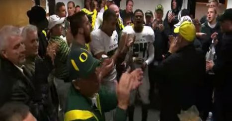 The team sings Mighty Oregon in the locker room after beating OSU