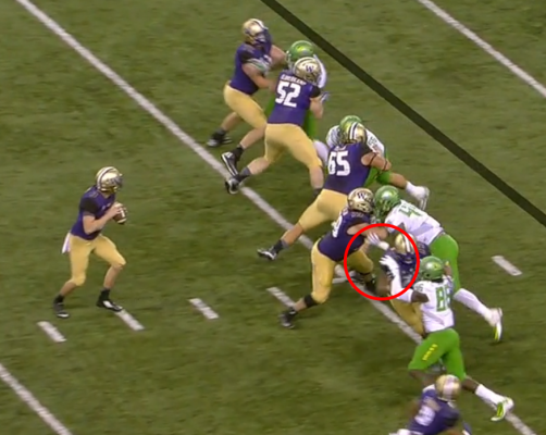 Buckner has the guard right where he wants him, and the RT is holding Torrodney Prevot's arm.