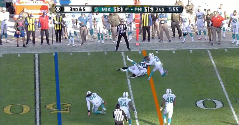 Josh Huff fights through three defenders to get a first down