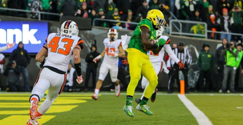 Bralon Addison scores one of his four touchdowns against Oregon State.