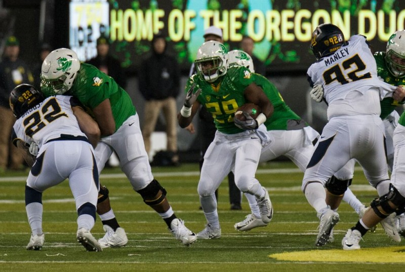 Kani Benoit with one of his eight carries for 94 yards against Cal.