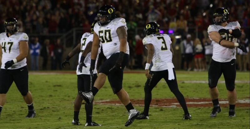 The Oregon offense celebrates a productive day in 38-36 win over Stanford.