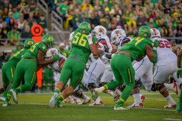 The Oregon Defensive line attacking
