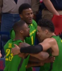 Jordan Bell, Elgin Cook, and Dillon Brooks celebrate.