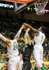 Jordan Bell (No. 1) joins the block party with Dillon Brooks.