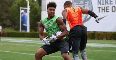 Dillon Mitchell, in green, was born to play offense for Oregon