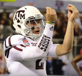 """Johnny giving the """"money"""" sign."""