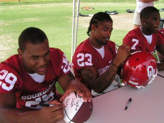 Oklahoma Sooners signing autographs.