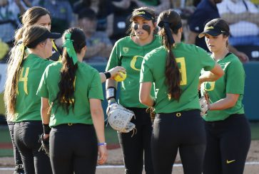 Oregon Ducks discuss strategy in a huddle.