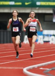 Perrin (right), kicks past another racer to win the 1500m title by .5 seconds.