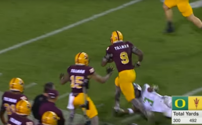 Kalen Ballage runs through Tyree Robinson in a triple overtime loss in 2015