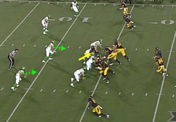 The beginning of the combo block by the Cal center.