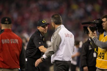 Coach Helfrich greeting Coach Meyer at the National Championship Game
