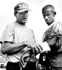Jack Harbaugh coaching QB Willie Taggart at Western Kentucky.