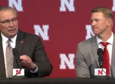 Photo of Scott Frost sitting next to Nebraska AD Bill Moos.